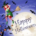 Halloween card with red-haired witch flying over moon