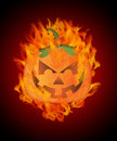 Halloween Carved Pumpkin with Flames Background Royalty Free Stock Photo