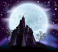 Halloween castle background with a spooky haunted and trees on a hill silhouetted against a full moon Royalty Free Stock Photography