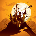 Halloween castle spooky in front of the moon Royalty Free Stock Photo