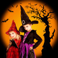 Halloween children girls with tree and bats Stock Photo
