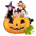 Halloween children wearing costume on pumpkin Stock Photo