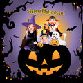 Halloween children wearing costume on on pumpkin Royalty Free Stock Photos