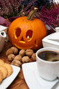 Halloween coffee composition theme with autumn elements arranged on a table Royalty Free Stock Image