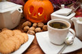 Halloween coffee composition theme with autumn elements arranged on a table Stock Images