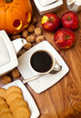 Halloween coffee composition theme with autumn elements arranged on a table Stock Image