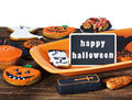 Halloween cookies and black label and holiday greetings on a plate orange Royalty Free Stock Photos