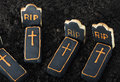 Halloween cookies and chocolate on the graves of cemetery land Stock Image