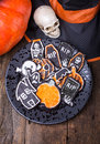 Halloween cookies sugar at a holiday party with pumpkins skull and witch hats Royalty Free Stock Images