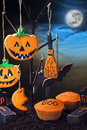 Halloween cookies on a tree against the night sky hanging in Stock Images