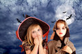 Halloween costumes kid girls on moon night Royalty Free Stock Images