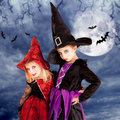 Halloween costumes kid girls on moon night Stock Images