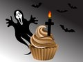 Halloween cupcake with chocolate mouse cross and ghost Royalty Free Stock Image