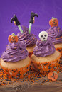 Halloween cupcake on purple background Stock Photo