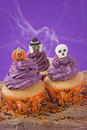 Halloween cupcake on purple background Stock Photography