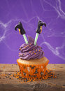 Halloween cupcake with witch legs Stock Photography