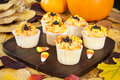 Halloween cupcakes with candy corns pumpkins and fall leaves Royalty Free Stock Image