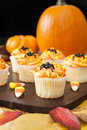 Halloween cupcakes with pumpkins candy corns and colorful leaves Stock Photography
