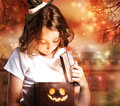 Halloween Cute Little Witch with Box Royalty Free Stock Photo