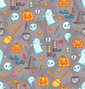 Halloween doodle seamless pattern in color with bunch of creepy sweet symbols Royalty Free Stock Photo
