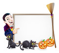 Halloween dracula sign with orange pumpkins and black witch s cats witch s broom stick and cartoon vampire character Stock Photography