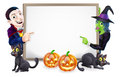 Halloween dracula and witch sign or banner with orange pumpkins black s cats s broom stick cartoon Royalty Free Stock Images