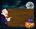 Halloween dracula wooden sign a cartoon with vampire pointing at a and scary pumpkin and bats flying in front of a Stock Photo