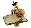 Halloween drink with magic book and bottles orange runes broomstick isolated Stock Photography