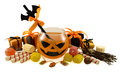 Halloween drink with sweets and gifts orange broomstick isolated Royalty Free Stock Photography