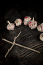 Halloween exorcism still life a a wooden cross and garlic bulbs Stock Image