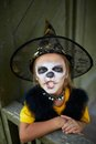 Halloween frightening portrait of cute girl in costume looking at camera with expression Royalty Free Stock Photography