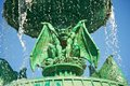 Halloween gargoyle green scary with water falling around it Stock Photography