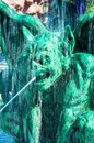 Halloween gargoyle green scary with water falling around it Stock Photos