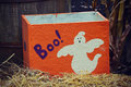 Halloween ghost box an orange painted with a white and purple letters that spell boo Stock Photo