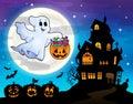 Halloween ghost near haunted house 2 Royalty Free Stock Photo
