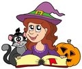 Halloween girl reading book Stock Photo