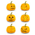 Halloween glowing pumpkins with different expressions Royalty Free Stock Images
