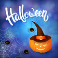 Halloween greeting card with pumpkin wearing hat, angry spiders, net and 3d brush lettering on blue background with