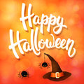 Halloween greeting card with witch hat, angry spiders and 3d brush lettering on orange background with bokeh elements