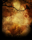 Halloween grunge background a flaming forest with bare branches and an owl in the tree in a concept concept for a Stock Photo