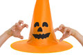 Halloween hat and scaring hand Royalty Free Stock Photo