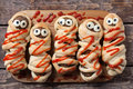 Halloween homemade food sausage meatball mummies Royalty Free Stock Photo
