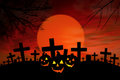 Halloween Jack O Lantern in spooky graveyard Royalty Free Stock Images