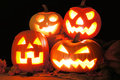 Halloween jack o lanterns group of lit up at night Stock Images