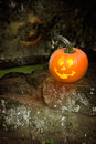 Halloween jack o lanterns lantern sitting on a stone wall at Stock Photo