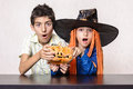 Halloween kids scary expression pumpkin boy and girl with shocked girl with witch black hat Stock Photography