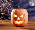 Halloween lantern pumpkin  in dark sky clouds Royalty Free Stock Images