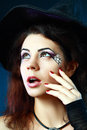 Halloween make up pretty young brunette woman dressed as a fairy or witch for party Royalty Free Stock Image