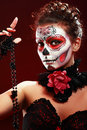 Halloween make up sugar skull beautiful model with perfect hairstyle santa muerte concept Royalty Free Stock Photo