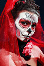 Halloween make up sugar skull beautiful model with perfect hairstyle santa muerte concept Stock Photography
